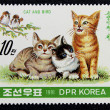 Postage stamp with the image of a kittens and birds — Stock Photo