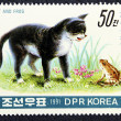 Postage stamp with the image of a cat and frog — Stock Photo