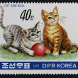 Postage stamp with the image of a kitten playing with a ball — Stock Photo