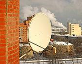 Satellite antenna on the wall — Stock Photo