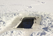 Hole in the ice for winter swimming — Stock Photo
