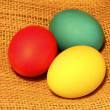 Multicolored Easter eggs on sacking — Stock Photo