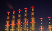 Industrial chimneys at night — Stock Photo
