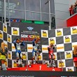 Russian stage of the Superbike World Championship, Award ceremony, Podium: 1 - Marco Melandri, 2 - Chaz Davies, 3 - Ayrton Badovini, on July 21, 2013, in Moscow Raceway, Moscow, Russia. — Stock Photo
