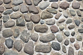 Background of the pavement of the large boulders — Stock Photo