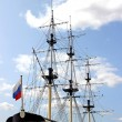 Mast sailing ship and a Russian flag — Stock Photo