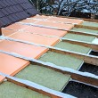 Stock Photo: Laying slabs of heat insulation material between beams in the co