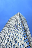 Modern multi-storey building, rotated around its axis — ストック写真