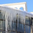 Many icicle hanging from the roof — Stock Photo #39425087