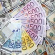 Euro banknotes on a background of one hundred dollars banknotes — Stockfoto