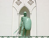 Bronze monument to the soldier in armor with a spear and a shiel — 图库照片