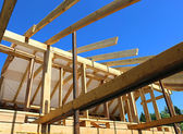 Installation of wooden beams at construction of frame house — Stock Photo