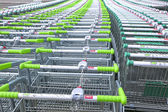 Rows of a plurality of shopping trolleys — Stock Photo