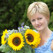 A woman with the sunflower — Stock Photo