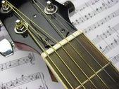 Music and guitar fretboard — Stock Photo
