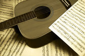 Notes and a guitar — Stock Photo
