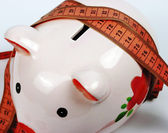 A moneybox and measuring — Stock Photo