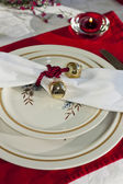 Christmas Table Setting reds and creams — Stock Photo