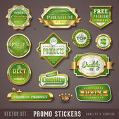 Green and golden quality stickers — Stok Vektör