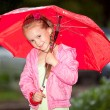 Stock Photo: Little girl under umbrella