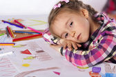 A tired child - an artist with a sketch — Stock Photo