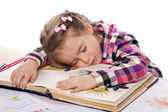 Sleeping child on a book — Stok fotoğraf