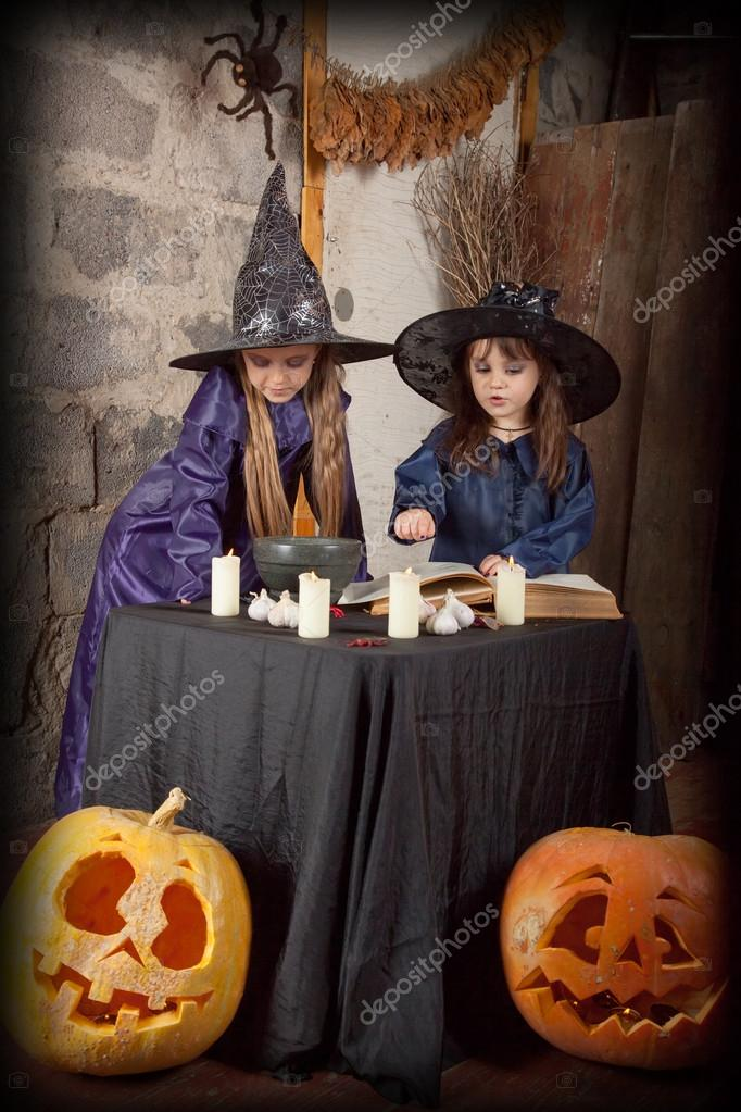 Two little witches conjure in an abandoned house — Stock Photo #12640449