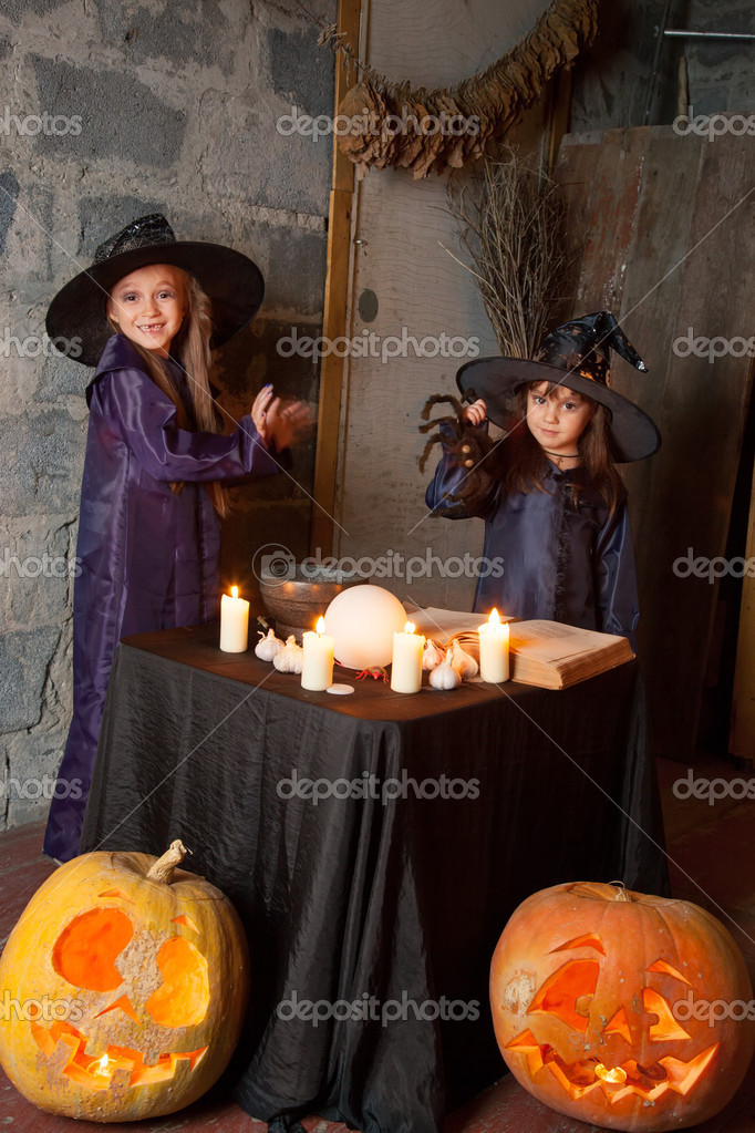 Two little witches conjure in an abandoned house — Stock Photo #12640534
