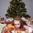 The girl with a gift under the Christmas tree — Stock Photo