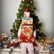 The girl with a gift under the Christmas tree — Stock Photo #14232689