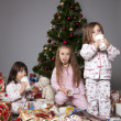 Three girls under the Christmas tree with gifts — Stock Photo #14232783