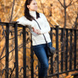 Fashion girl in autumn park — Stock Photo