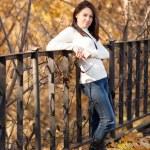 Fashion girl in autumn park — Stock Photo #16774743
