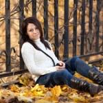 Fashion girl in autumn park — Stock Photo #16774747