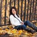 Fashion girl in autumn park — Stock Photo #16774761