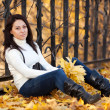 Fashion girl in autumn park — Stock Photo #16774767