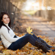 Fashion girl in autumn park — Stock Photo #16774825