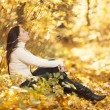 Fashion girl in autumn wood — Stock Photo #17002031