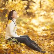 Fashion girl in autumn wood — Stock Photo #17002053