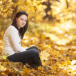 Fashion girl in autumn wood — Stock Photo