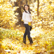 Fashion girl in autumn wood — Stock Photo #17002117