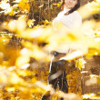 Fashion girl in autumn wood — Stock Photo #17002129