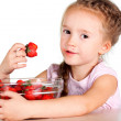 Stock Photo: A child with a bowl fresh strawberries