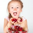 A child with a bowl fresh cherry — Stock Photo #17353753
