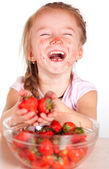 A child with a bowl fresh strawberries — Stock Photo