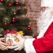Stock Photo: SantClaus brings Christmas gift