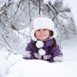 Wonderful child in the snowy woods — Stock Photo #46732793