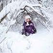 Wonderful child in the snowy woods — Stock Photo #46732803