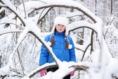Wonderful child in the snowy woods — Stock Photo