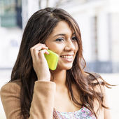 Smiling Young Woman Talking on the phone. — Stock Photo